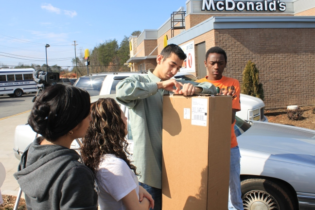 students open boxes